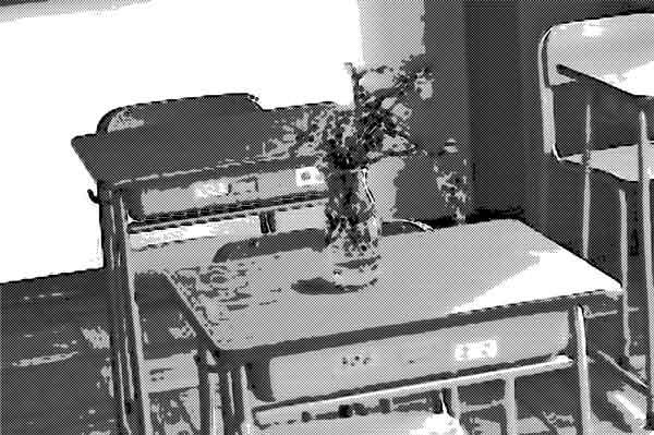 机の上には『亡くなりました』のサイン